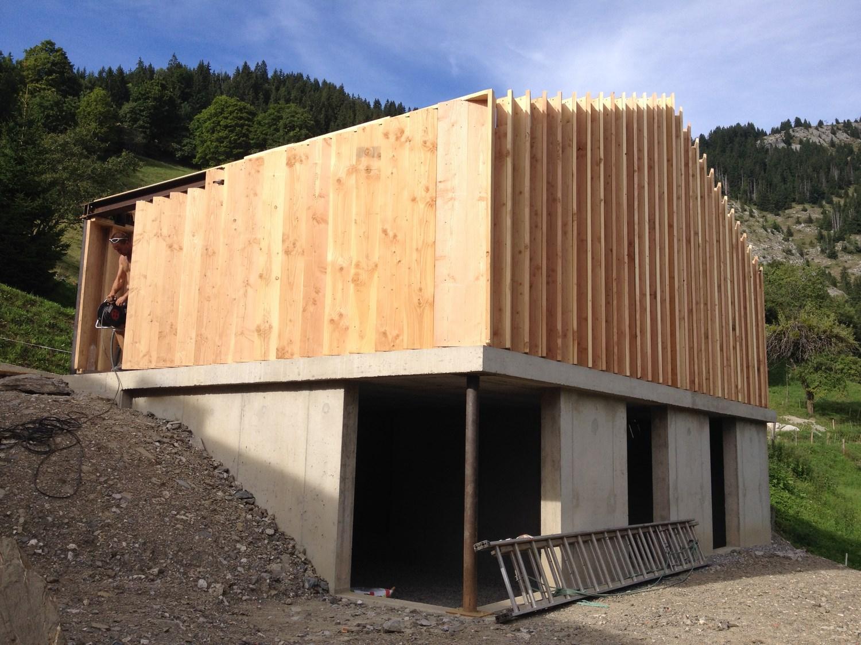 Garage comburce alternative construction bois for Reglementation construction garage
